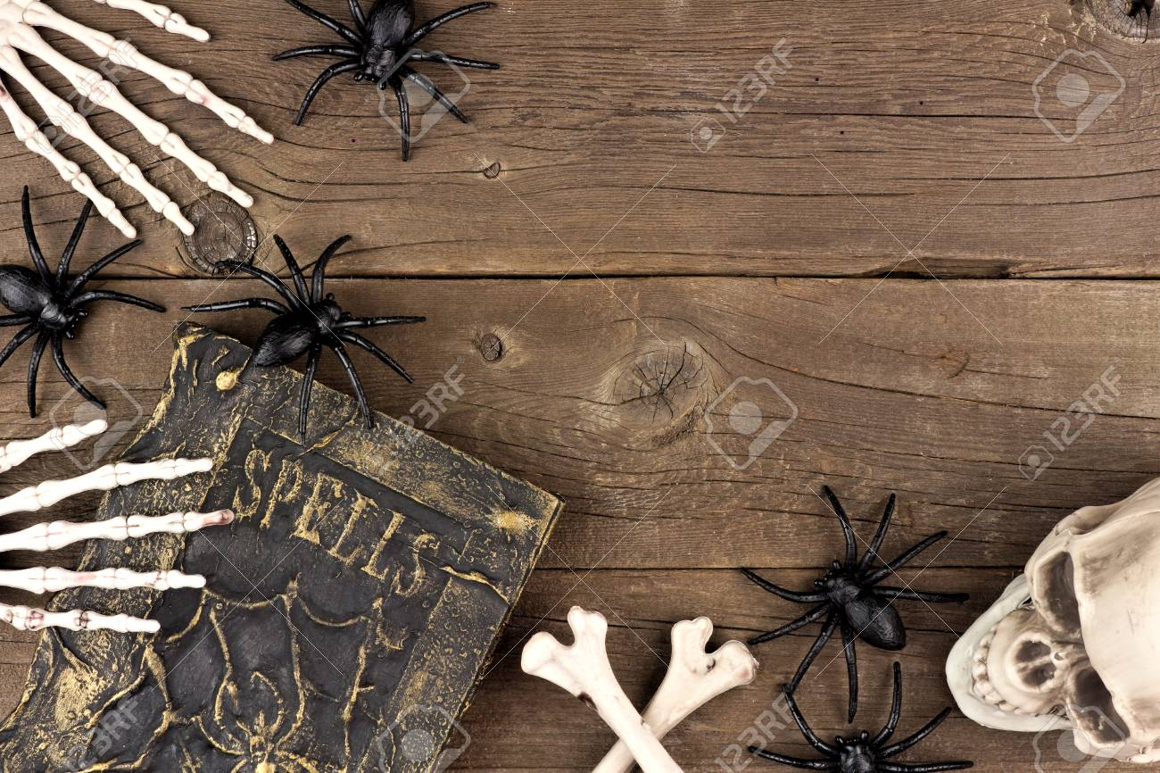 Halloween Corner Border Of Black And White Decor Over A Rustic Old Wood Background Stock Photo