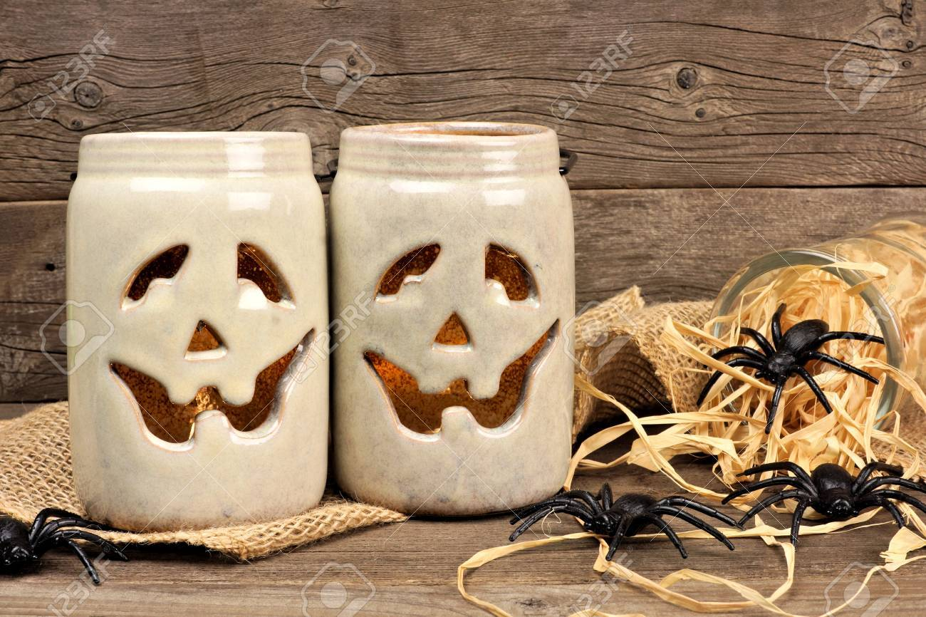 Rustic Mason Jar Jack O Lanterns With Of Spiders Against An Old Wood Background Stock