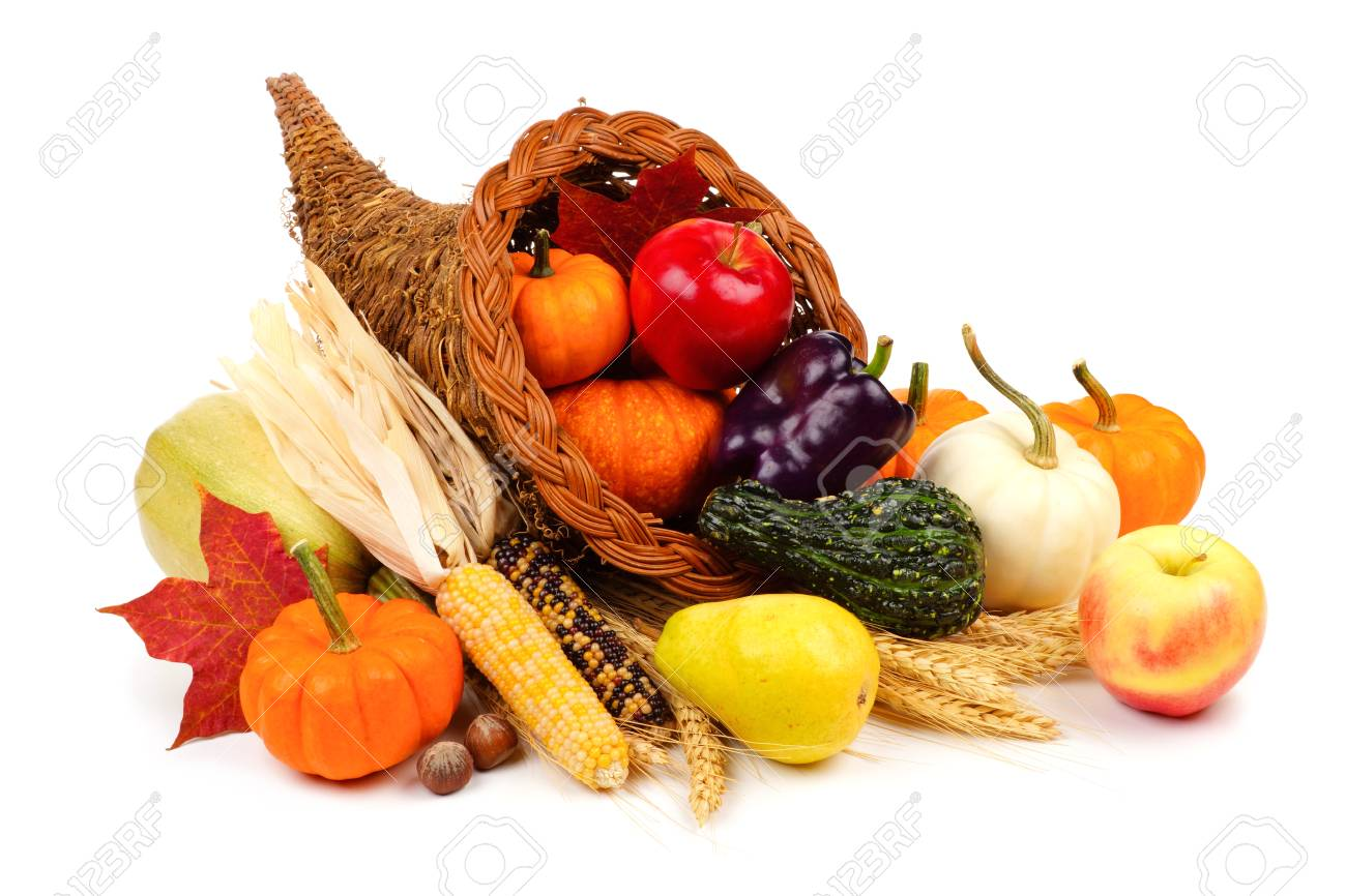 Thanksgiving cornucopia filled with fruit and vegetables isolated on a white background - 87237781
