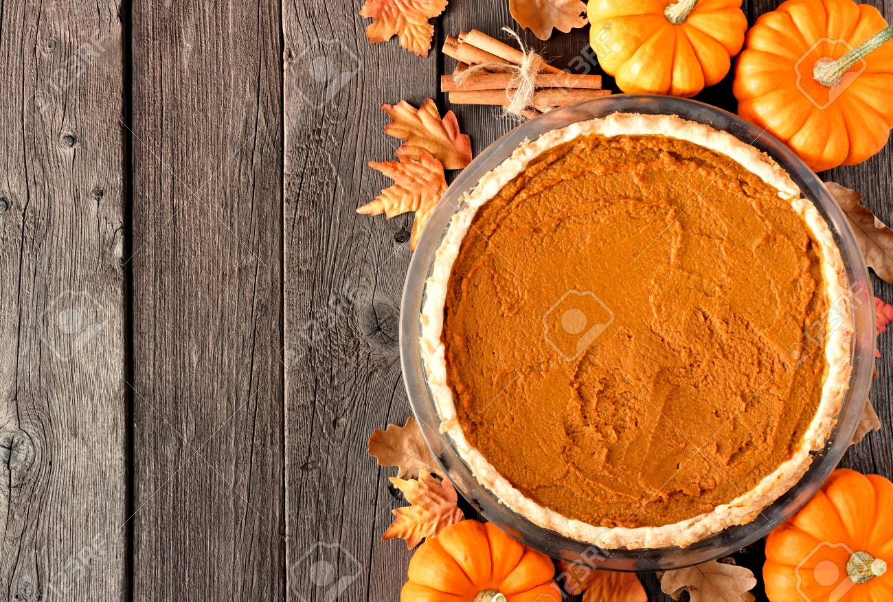Autumn Pumpkin Pie Overhead Table Scene On A Rustic Wood Background Stock Photo
