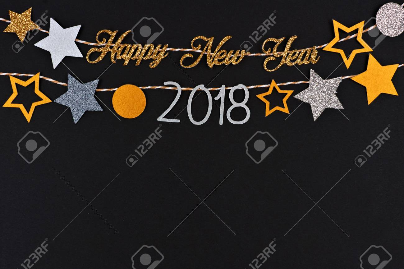 happy new year 2018 glitter text banner with strings of gold and silver stars against a