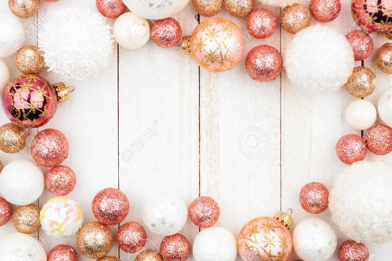 Christmas Frame Of Rose Gold White And Gold Ornaments On A White