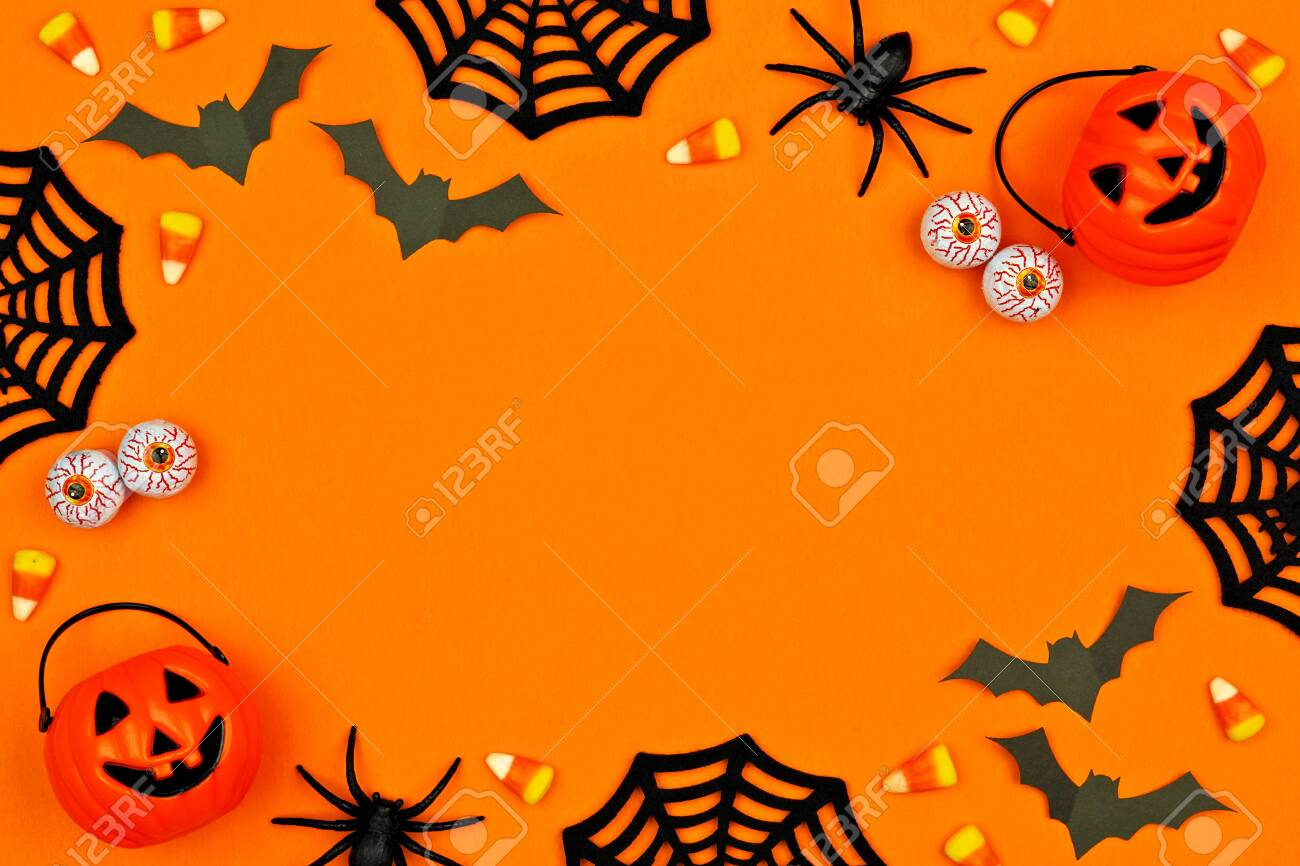 Halloween decor frame over an orange background with copy space - 130017177