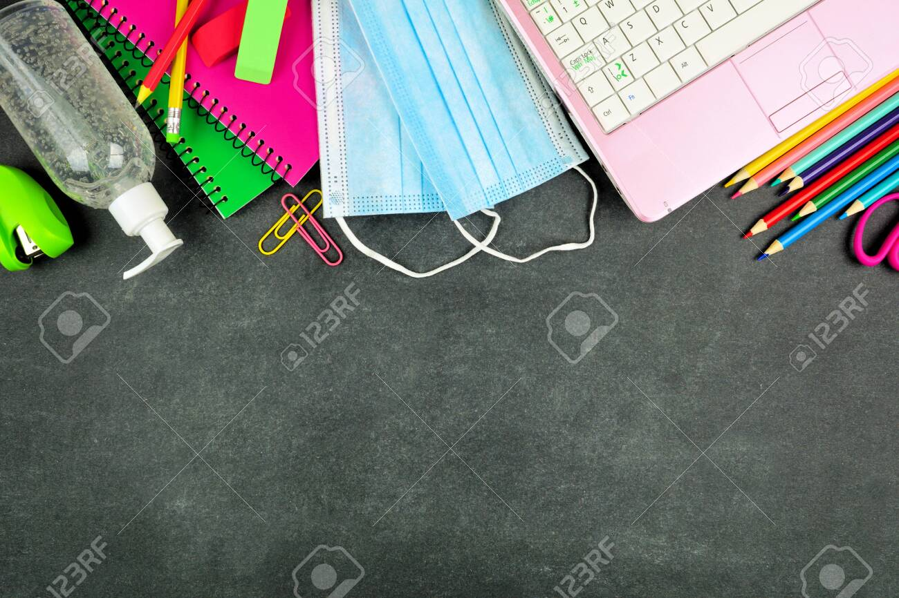School supplies and coronavirus prevention items. Top border on a chalkboard background. Back to school during pandemic concept. - 151382587