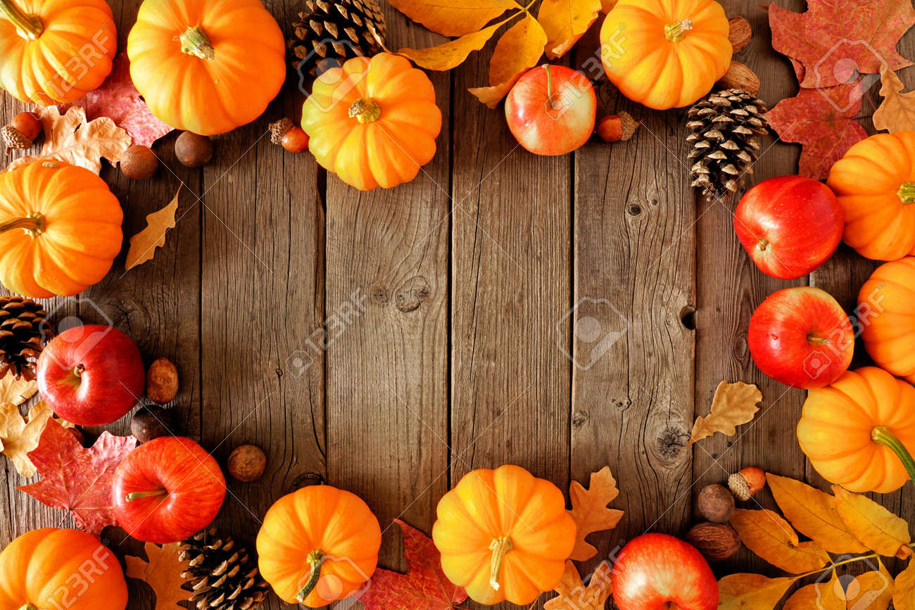 Autumn decor on a white shelf against a white wall background. Banner with copy space. Candle, branches, pumpkin. - 156142822
