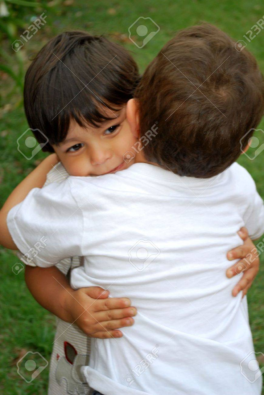 Two cute little boys hugging each other Stock Photo - 4687952