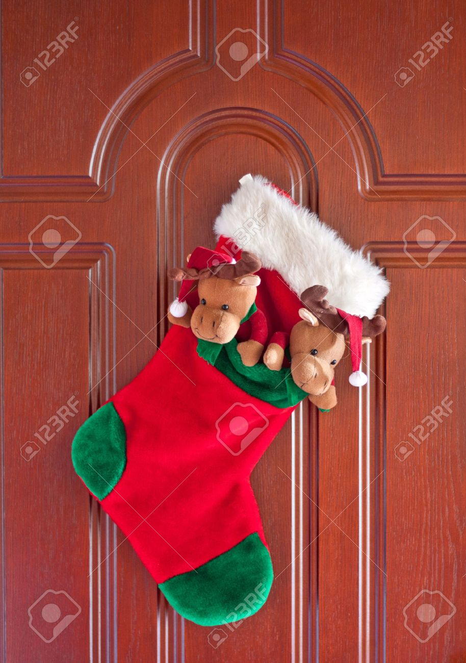 Red christmas sock for presents on the front door Stock Photo - 11328599 & Red Christmas Sock For Presents On The Front Door Stock Photo ...