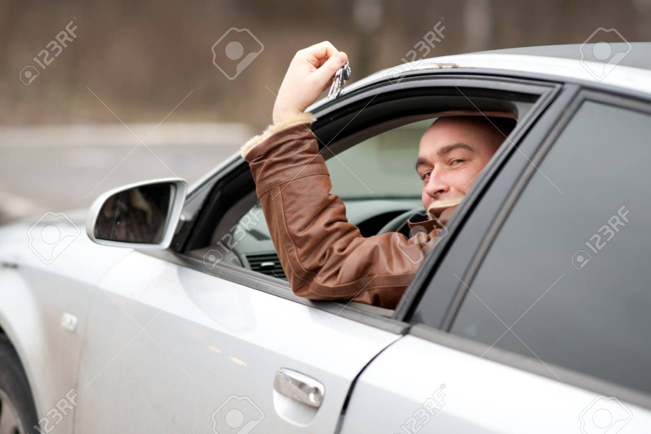 man in the car with keys in a hand Stock Photo - 11764972
