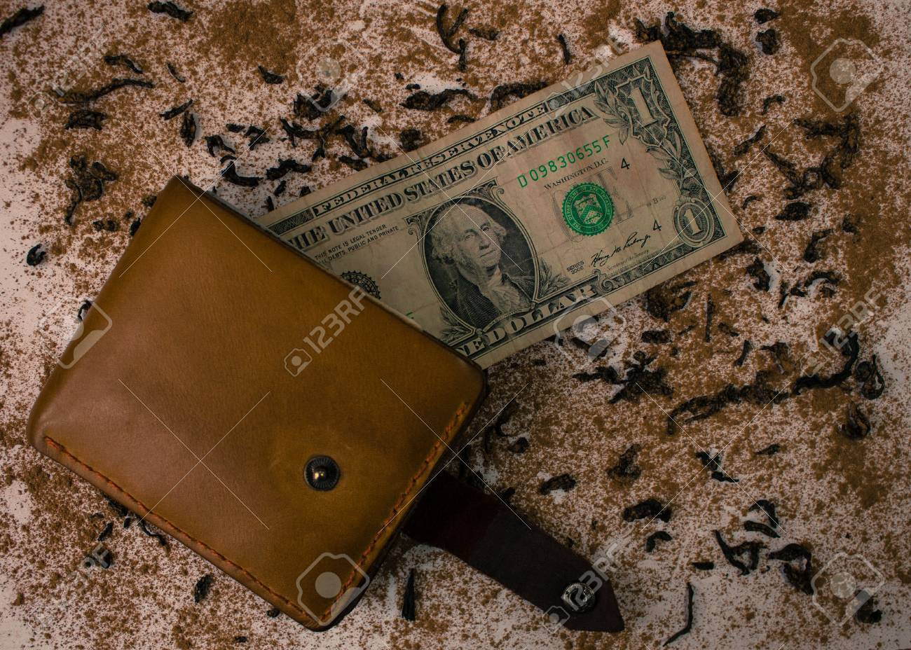 Wallet with dollar on the background of scattered tea and cinnamon