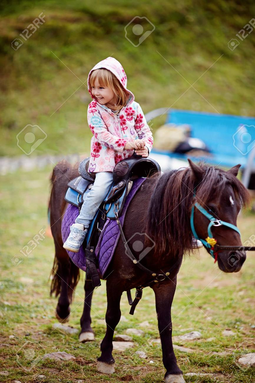 Kids Riding Pony In The Alps Mountains Family Spring Vacation Stock Photo Picture And Royalty Free Image Image 110958328
