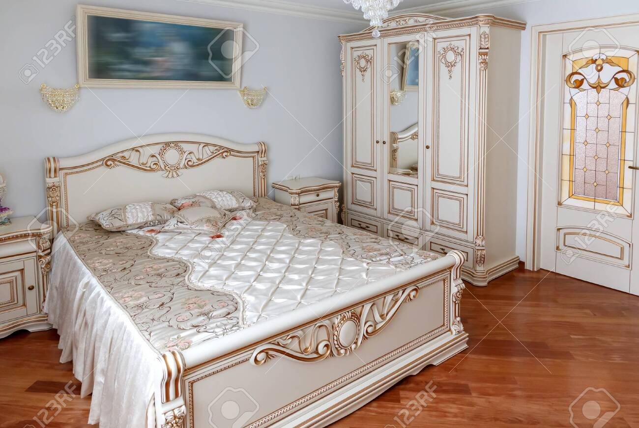 Detail of the bedroom. bed and bedside tables decorated with..