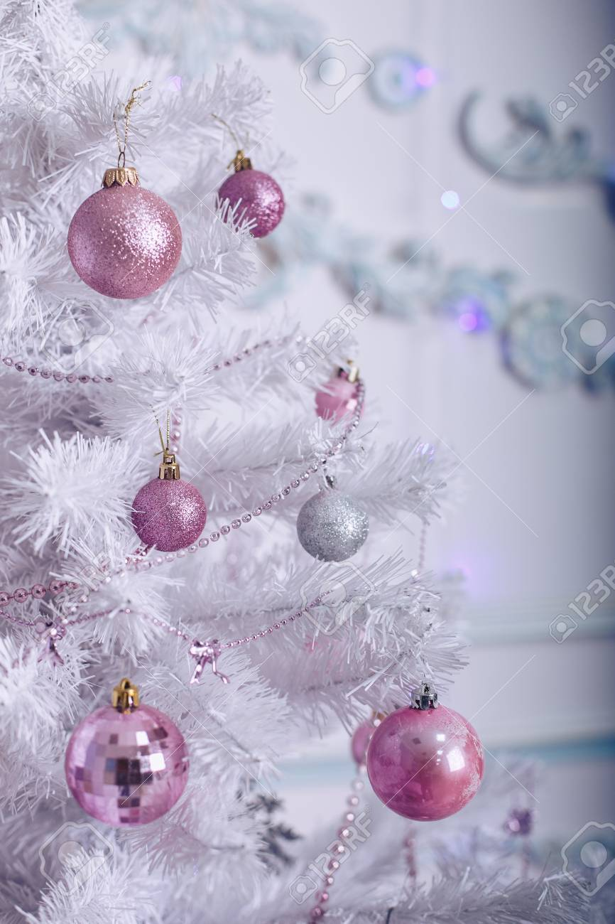 Christmas Tree With Pink And White Toys In Light Tones Stock Photo Picture And Royalty Free Image Image 93752650