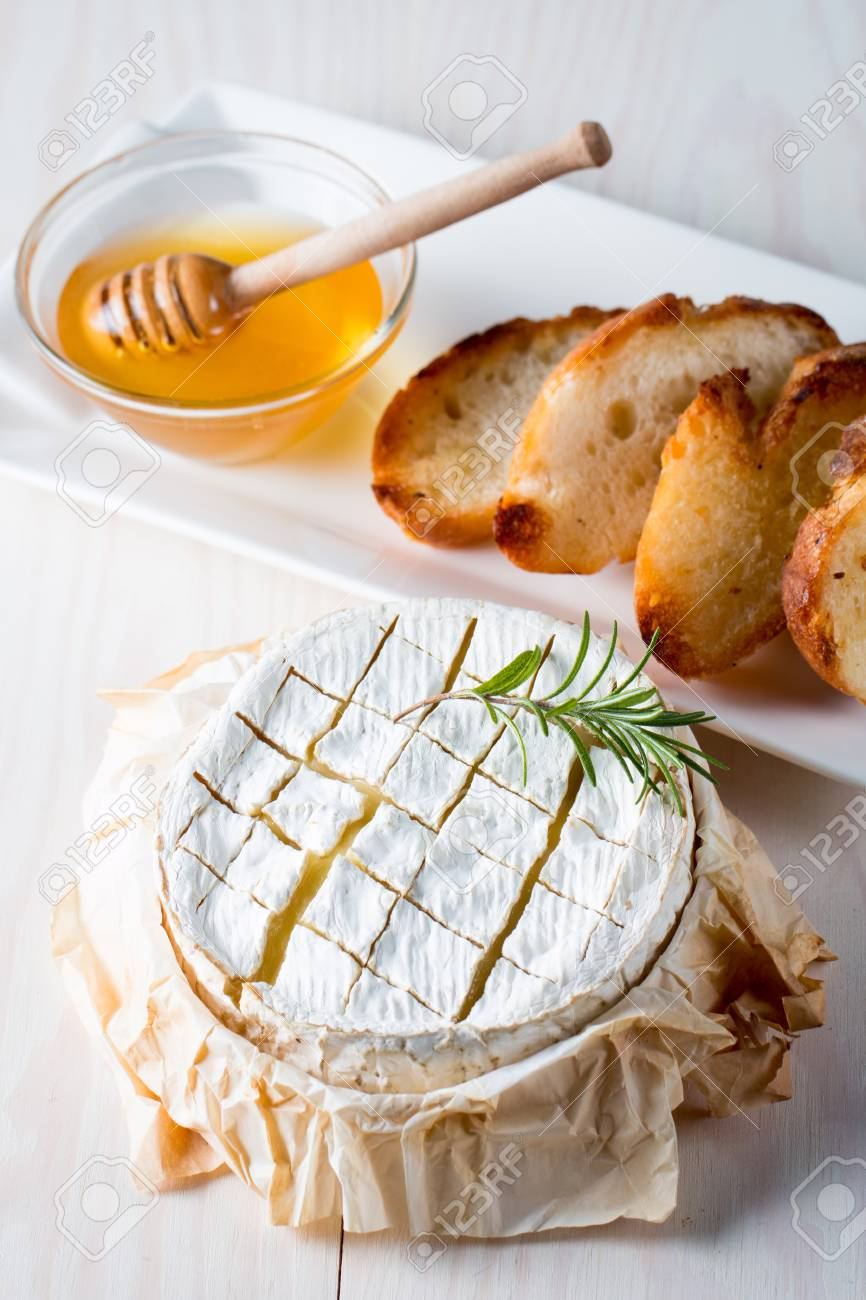 Baked Camembert Cheese Fresh Brie Cheese And A Slice On A Wooden