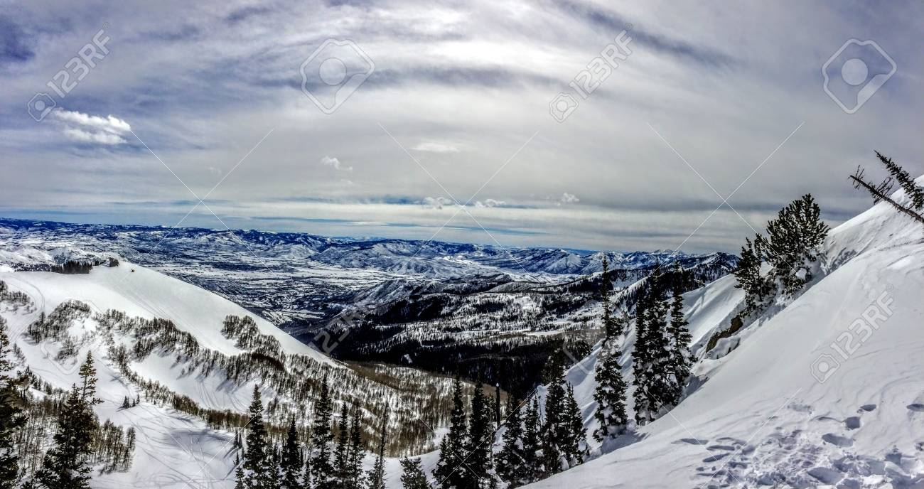winter panoramic view of the back of the wasatch mountains utah