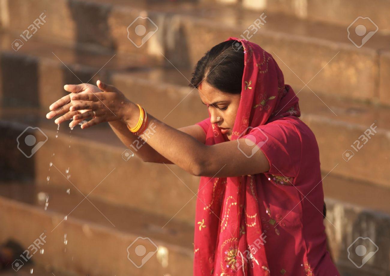 Varanasi, India - October 12, 2007: Hindu lady making an offering to the gods in the Ganges River at Varanasi, India Stock Photo - 6885547