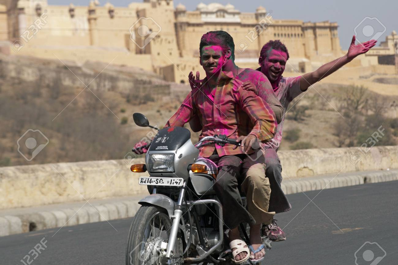 Jaipur, Rajasthan, India - March 22, 2008: Group of young Indians on a motorbike covered in colored paint from celebrating the Hindu Festival of Holi at Amber Fort, Jaipur, Rajasthan, India. Stock Photo - 6888075