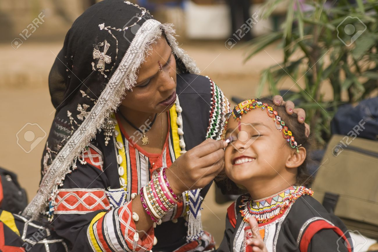 Young Rajasthani dancer gets ready to perform at the Sarujkund Fair near Delhi in India. Stock Photo - 7878299