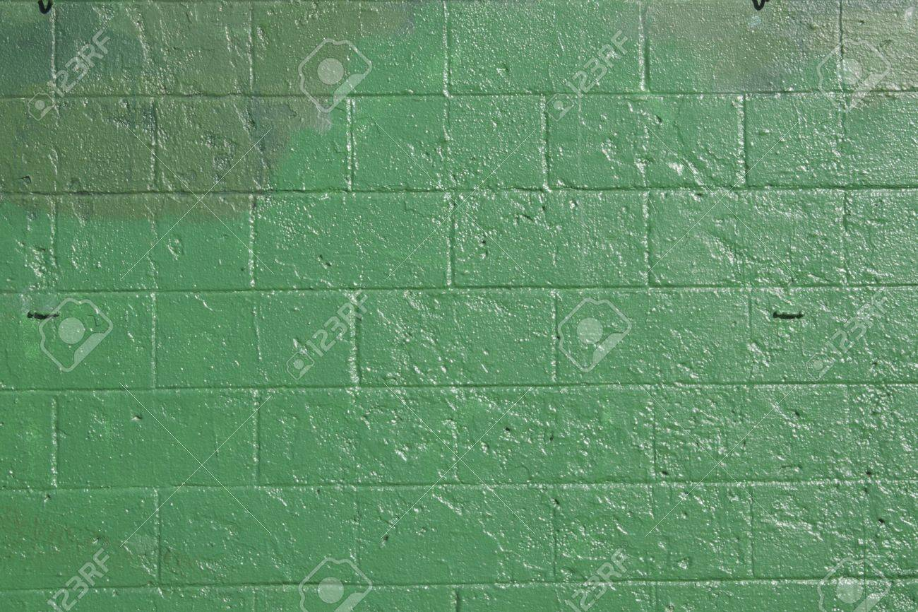green brick wall that has been covered up with off shades of green to cover grafitti. Stock Photo - 9888527