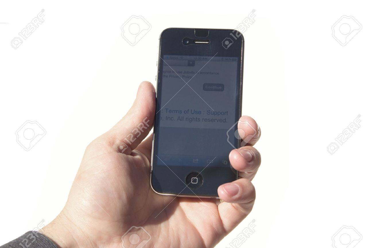 Verdi, Nevada, USA - Febuarary 8, 2012: A mans hand holding an iPhone 4s. Close-up shot of his hand and the iPhone screen. The cellular phone is produced by Apple Computer, Inc. Stock Photo - 12271918