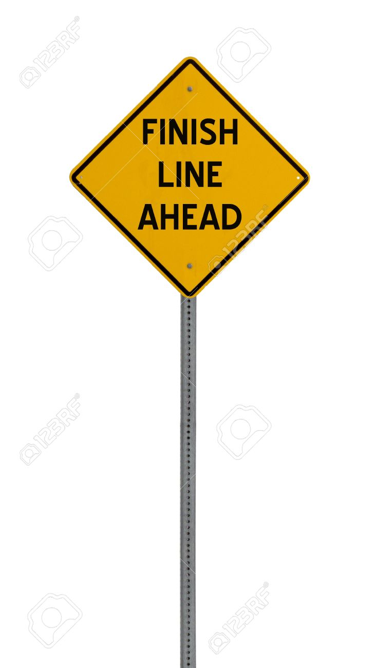 a yellow road sign with the words FINISH LINE AHEAD on white background Stock Photo - 12688953