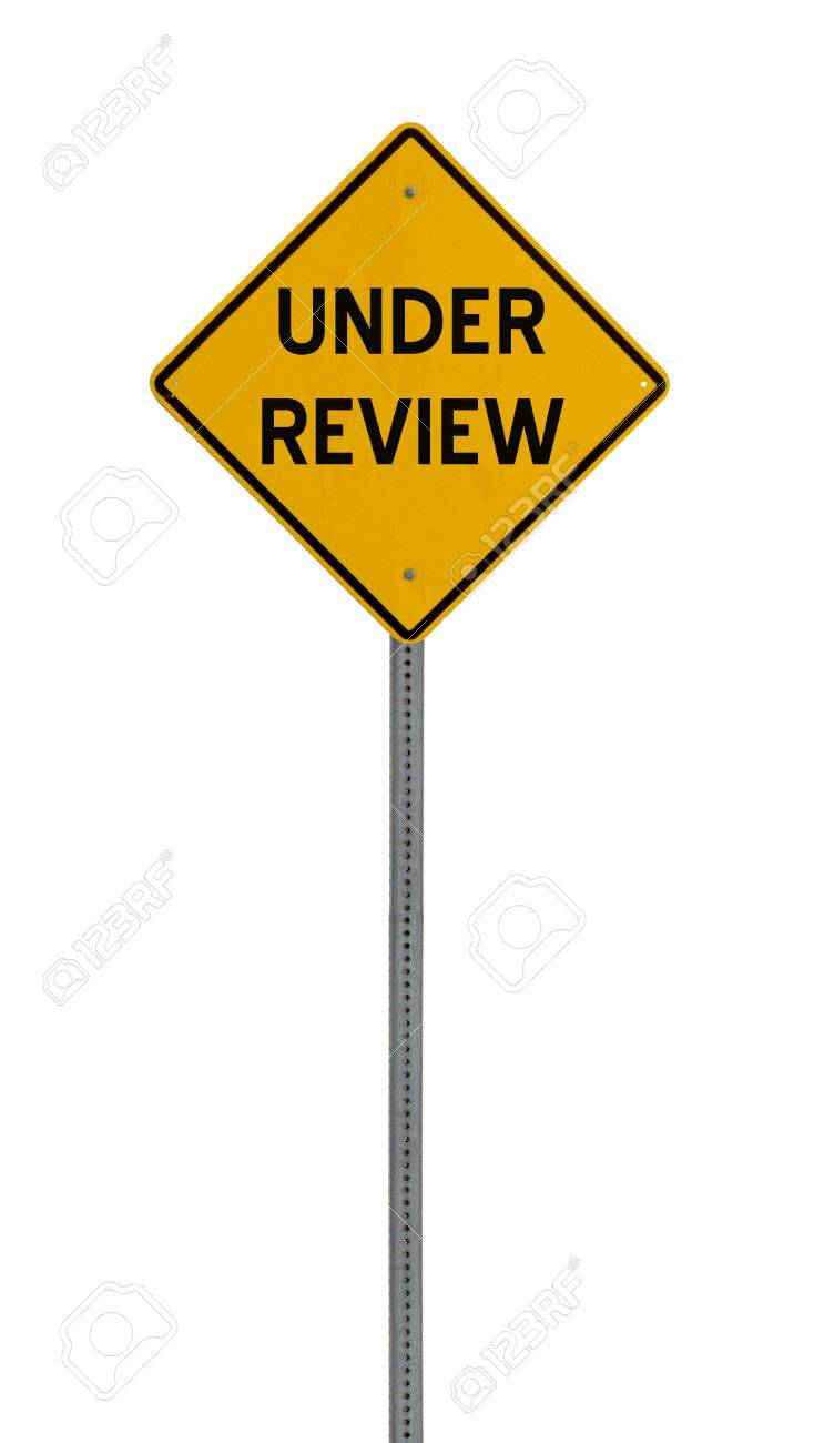 a yellow road sign with the words UNDER REVIEW on white background Stock Photo - 12688945