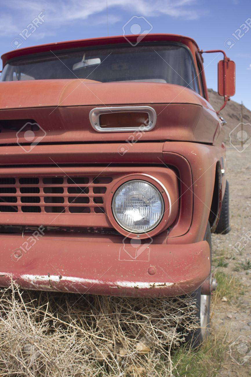 an old rusty pickup truck in the desert. Blue skies and tumbleweeds. Stock Photo - 18978141