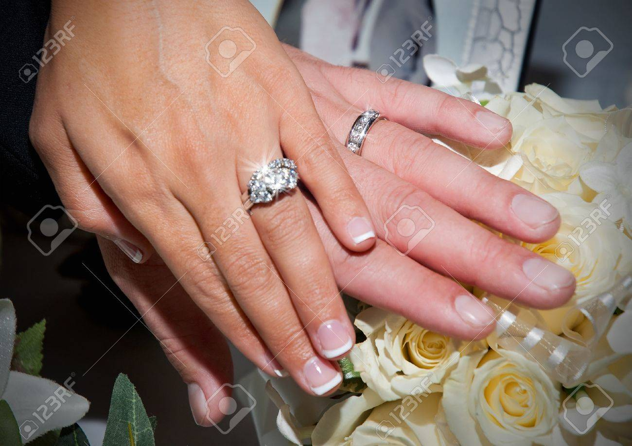 Wedding Rings On Hands Stock Photo, Picture And Royalty Free Image ...