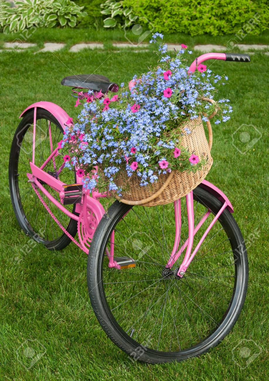 old pink bike as yard decor piece stock photo 36648766 - Yard Decor