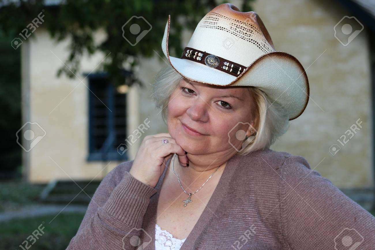 Grinning Woman Wearing Cowboy Hat Poses For Camera Stock Photo - 49573986 e21ceec1a3de