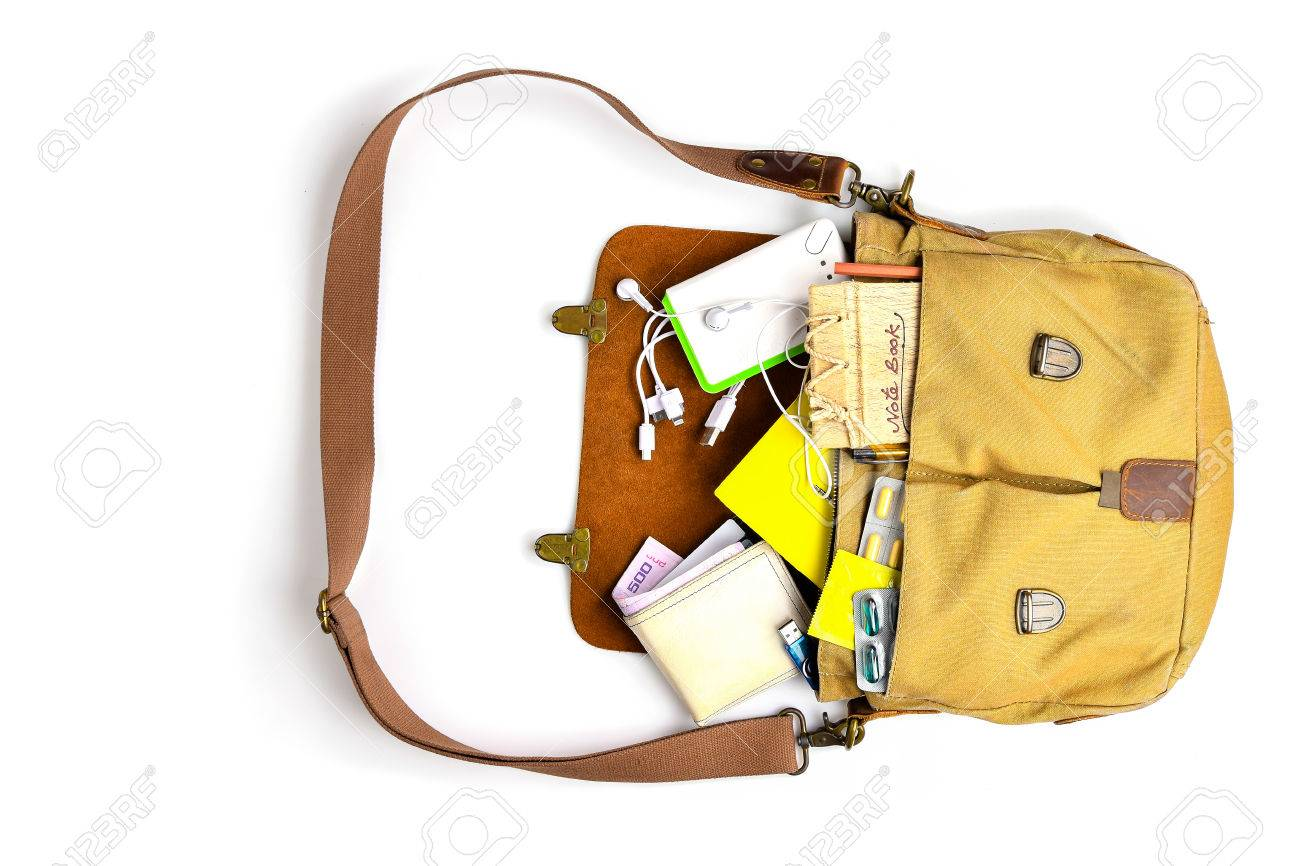 327dfd706ff2 Stock Photo - Top view,Men Bag with essentials for modern men person on  white table .leather bag, smartphone,power bank, notepad, book,keys,  medicine pills ...