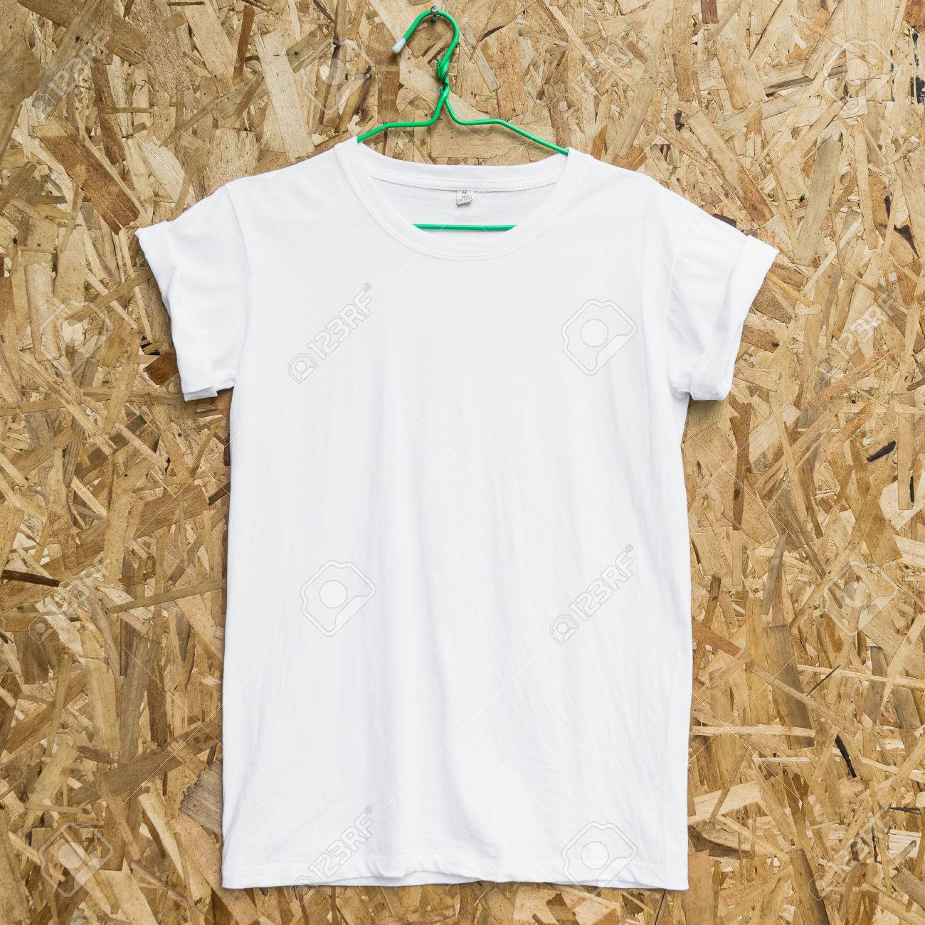 Blank Front White T Shirt Template Mockup On Wood Background Stock