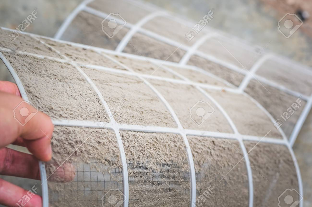 Close up dirty dust on air conditioner filter ,Cleaning or changing the filter in the air conditioning for safe healthy housing air conditioning. - 120637896