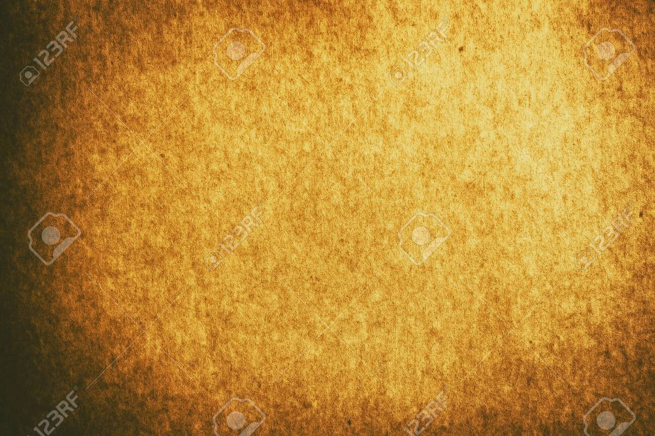 Full frame old gold brown paper texture background with vignette for design backdrop or overlay design - 128188159