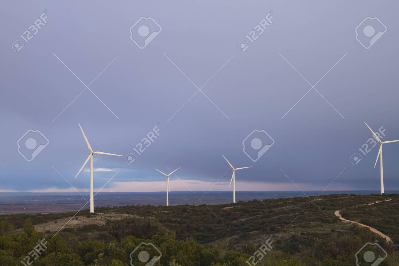 Wind turbines farm generating clean renewable energy - 149491544