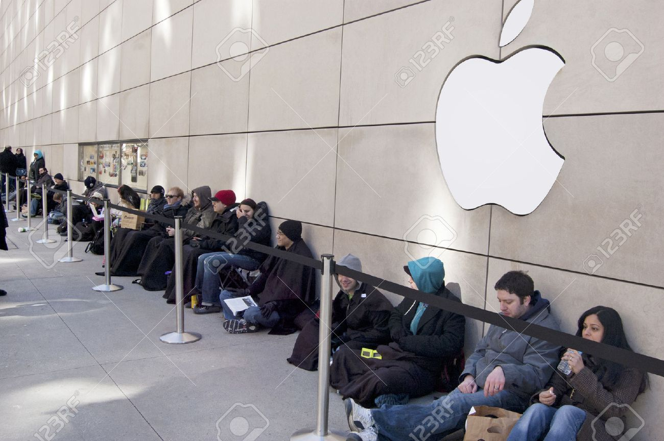 Customers Waiting in Line Outside of the Apple Store on Michigan