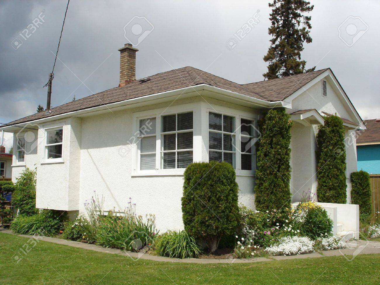 Little white stucco house 2 stock photo 2397012