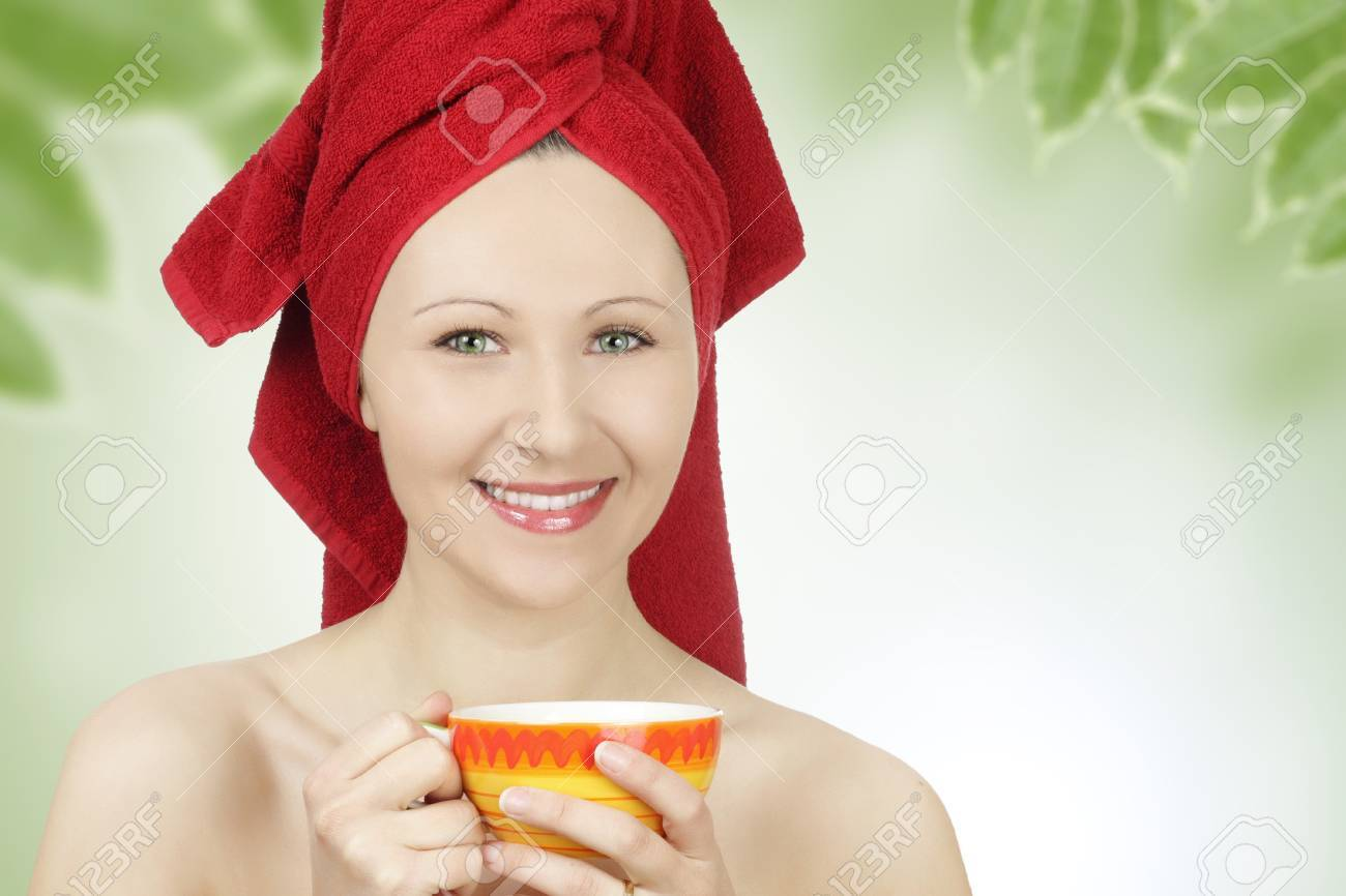 Young woman with towel drinking tea after sauna Stock Photo - 8918814