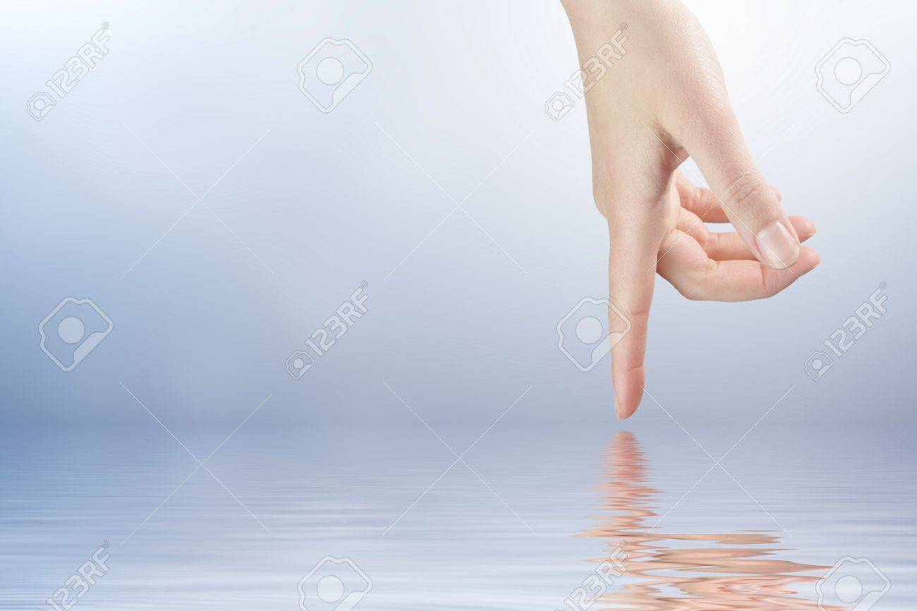 Female finger touching the water surface level Stock Photo - 8918836