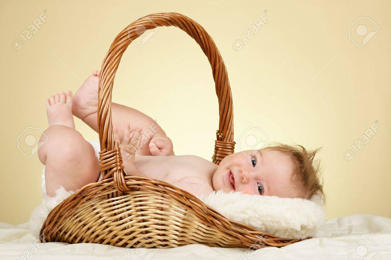 Adorable baby boy in wicker basket Stock Photo - 10254046