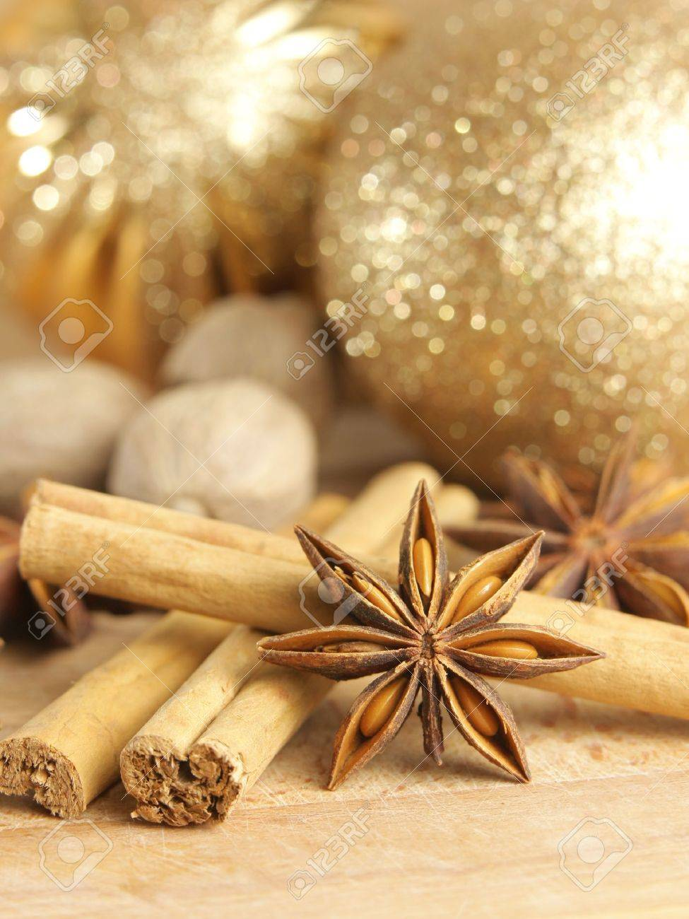 Christmas spices and baubles on wooden board Stock Photo - 11118730