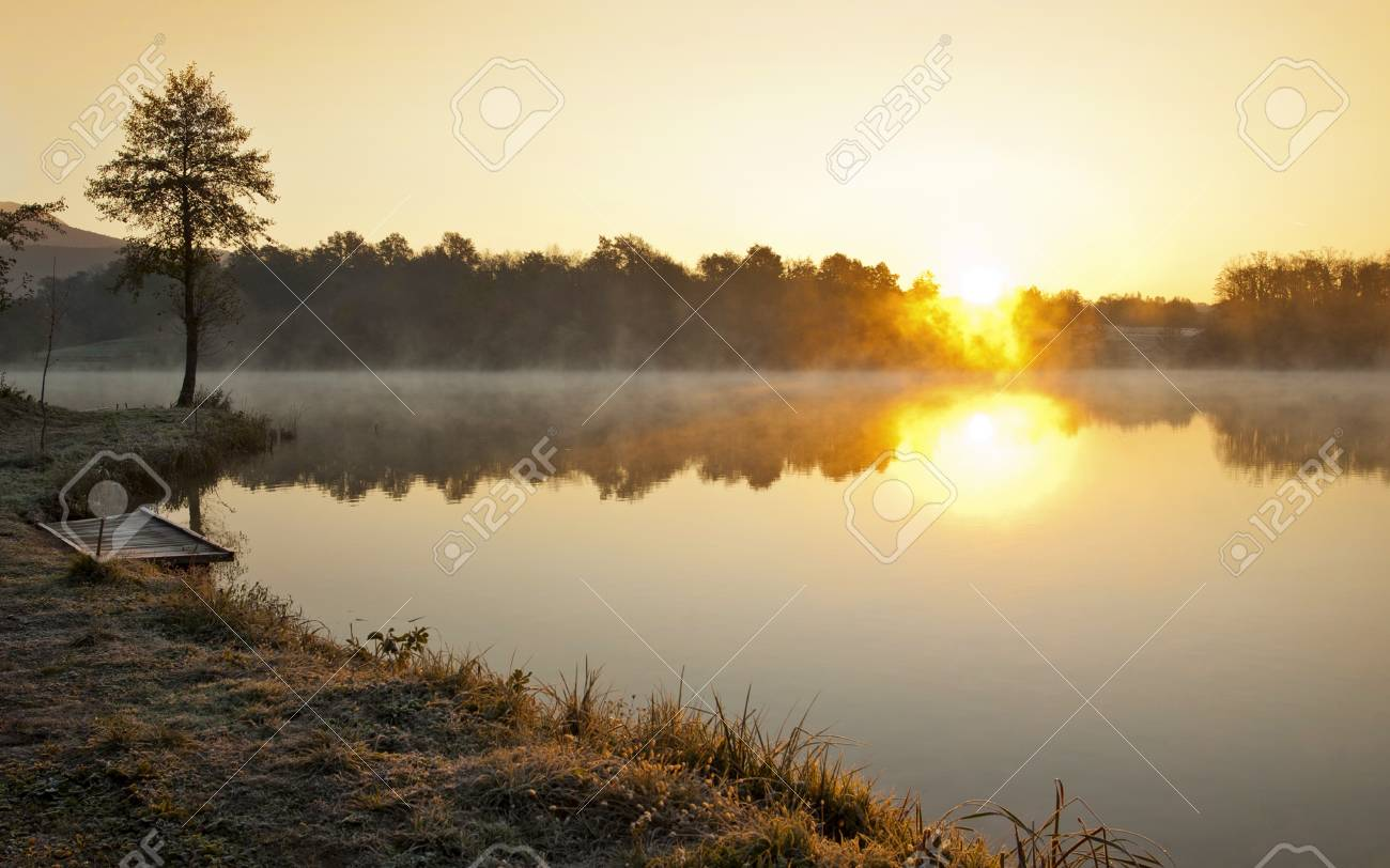 Misty lake in early winter morning Stock Photo - 11374429