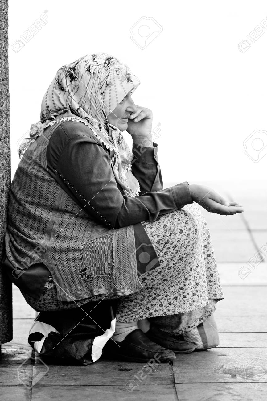 Sarajevo, Bosnia and Herzegovina - AUGUST 14 - An unidentified muslim woman begs on August 14, 2011 in in Sarajevo, capital city of Bosnia and Herzegovina. - 12182323