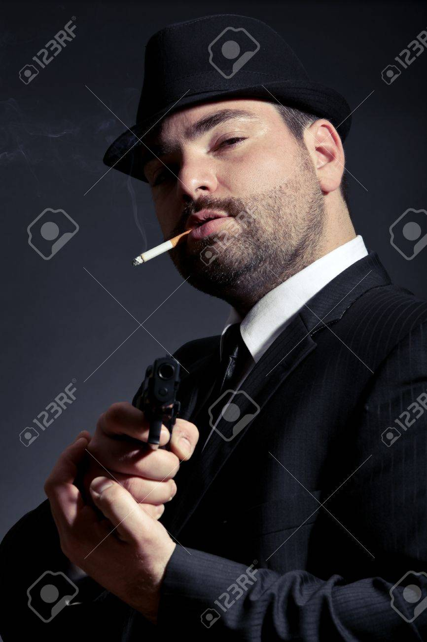 Dangerous man in suit with a gun Stock Photo - 12181712