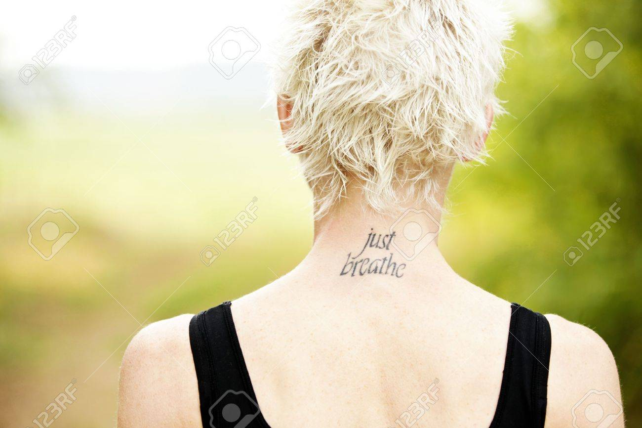 View of female runner back with tatoo Stock Photo - 13113441