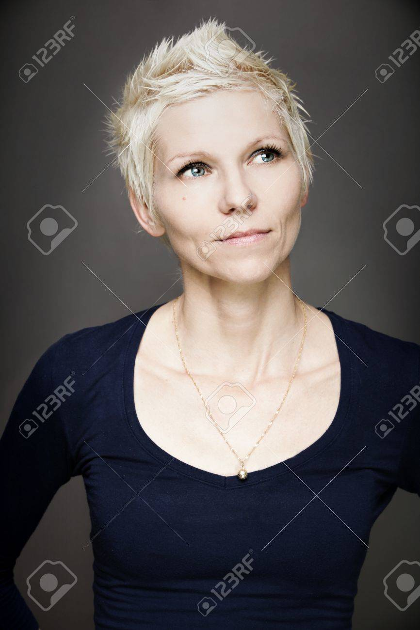Portrait of blond woman with blue contact lenses - 14627685