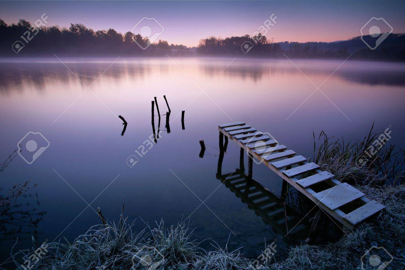 Misty lake in early morning - 15529932