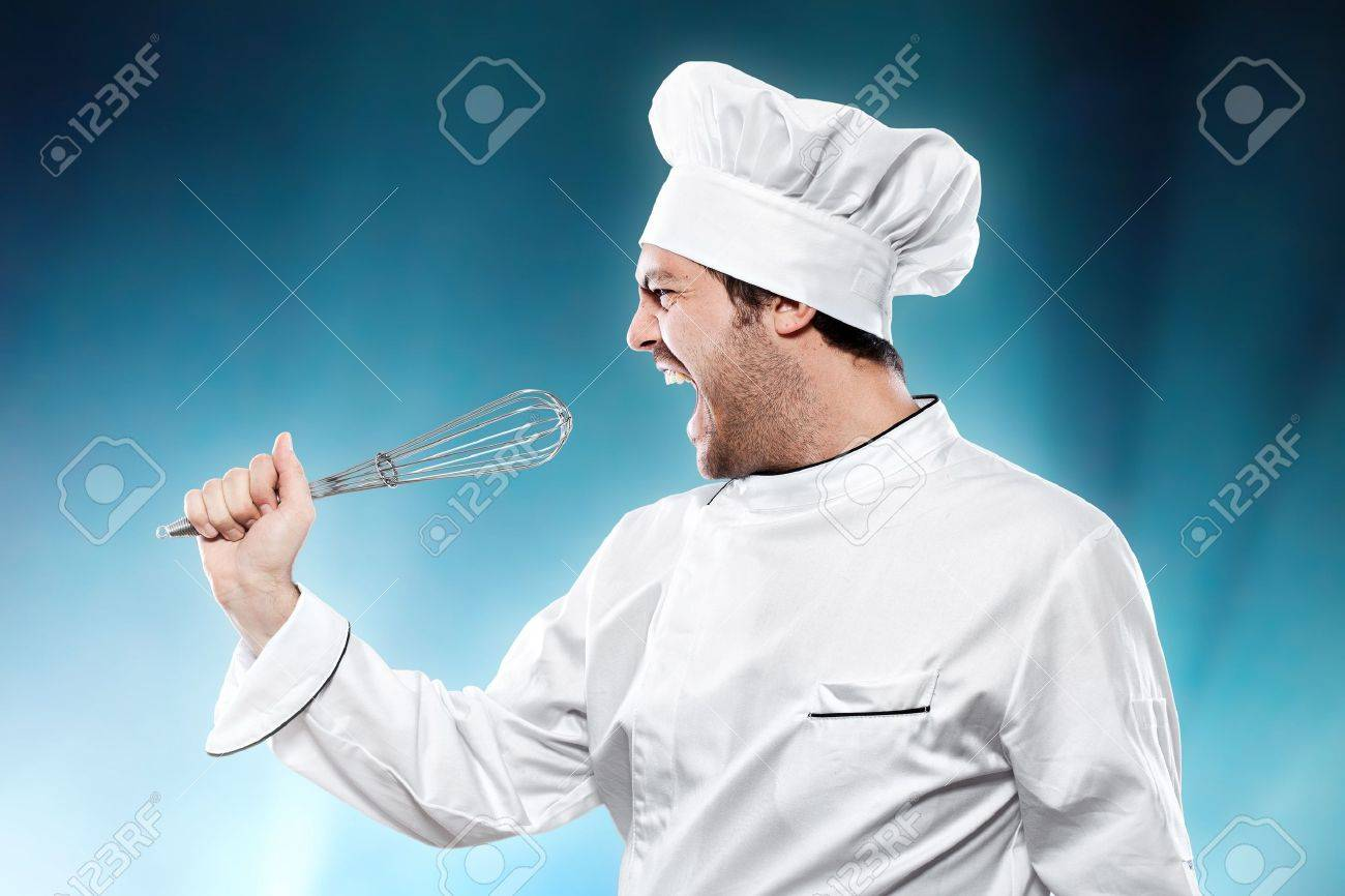 Singing chef against blue background Stock Photo - 15985419