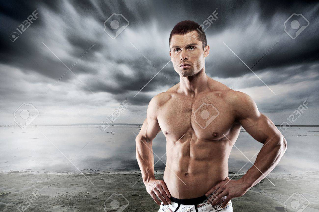 Muscular man posing against dark background Stock Photo - 16244573