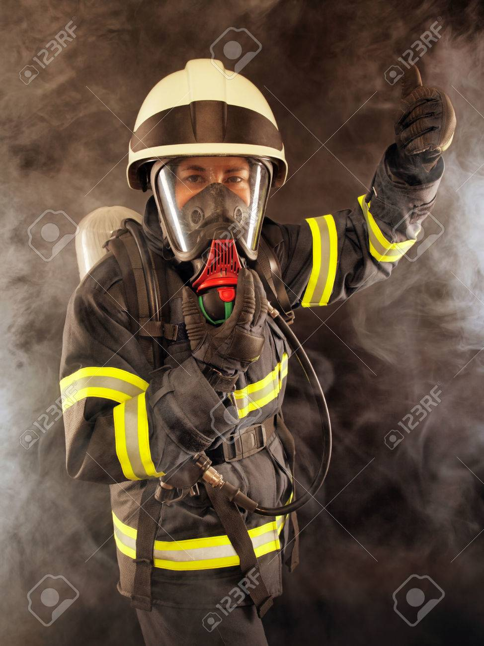Firefighter wearing protective suit, helmet and mask - 25024987
