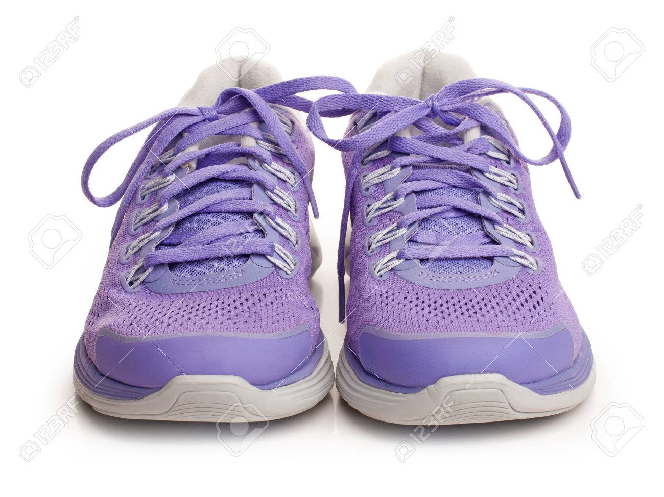 Purple female sport shoes isolated on white - 25410821